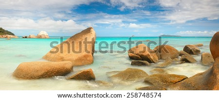 Landscape Panorama Seychelles lagoon with  stones and with a clear turquoise sea - stock photo