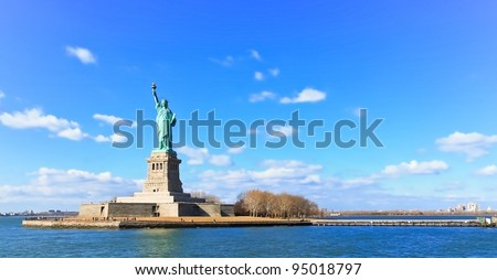 Landscape panoramic view of The Statue of Liberty - stock photo