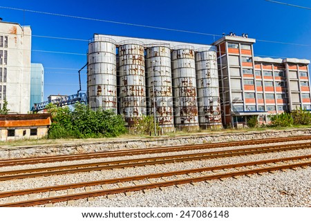 Landscape photo of an old abandoned grain silo. - stock photo