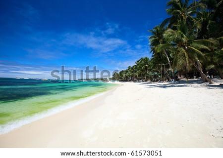Landscape photo of beautiful white sand exotic beach - stock photo