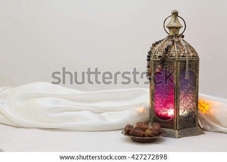 Landscape Photo Of lantern, rosary and Dates, use it as poster, Greeting card, Brochure - stock photo