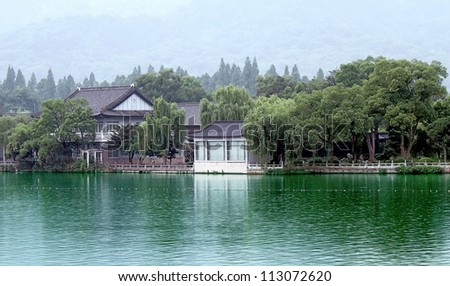 Landscape photo of Traditional Chinese village along a river, The Wuzhen near Shanghai, typical water town building style in China - stock photo