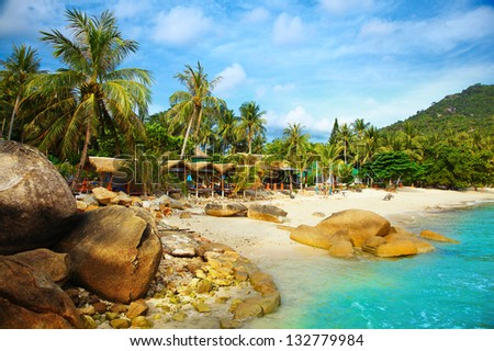 Landscape photo of tranquil island beach resort - stock photo