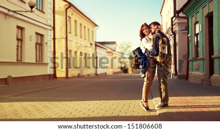 Landscape portrait of young beautiful stylish couple sensual and having fun outdoor in summer. - stock photo