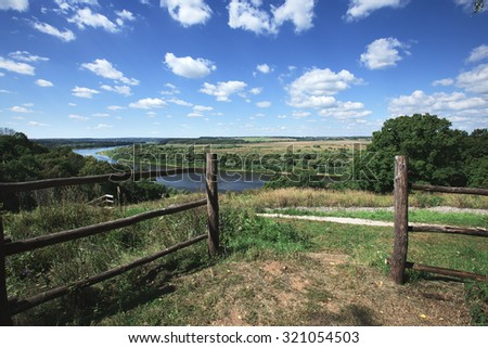 landscape. River under blue sky with clouds. Russia, the river Oka