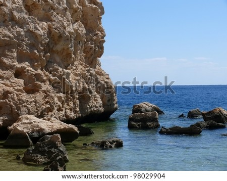 landscape rocks against the sea. sunny day.