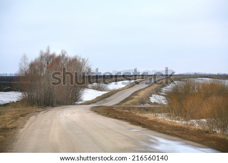 landscape season of bad roads, slush and snow melt in early spring - stock photo