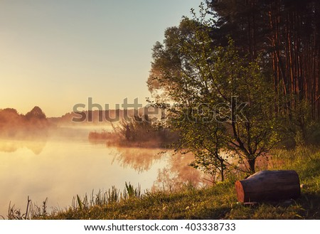 Landscape. shore of river, lake in the morning mist. late fall