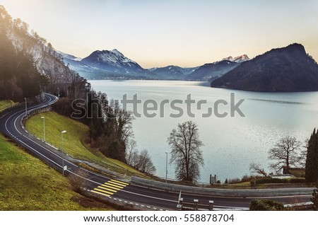 Landscape spring, a view of the sunrise on the mountain lake, sky and the road. Switzerland, Europe