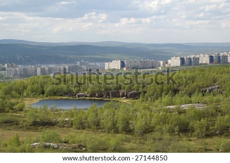 landscape summer view of murmansk with the little lake on the foreground - stock photo