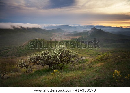 Landscape. Sunset over the mountains with clouds - stock photo