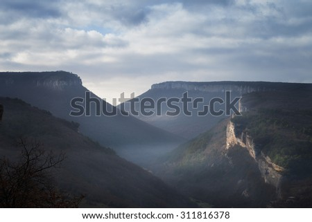 Landscape. The mountains under the blue sky with clouds - stock photo