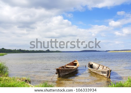 Landscape two boats on the lakes of Braslav - stock photo