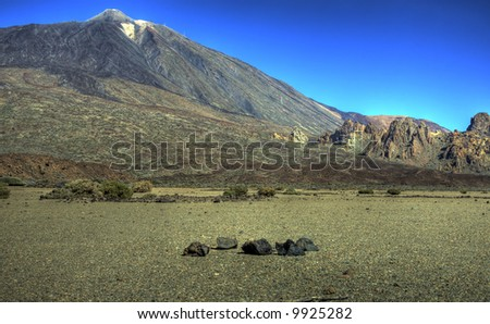 Landscape view across a crater bed towards the peak of Teide at the Teide National Park, Tenerife - stock photo