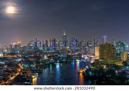 Landscape view Building central business district of Bangkok at night, full moon. - stock photo