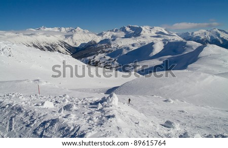 Landscape view from the Peak of Whistler Mountain looking towards Blackcomb - stock photo