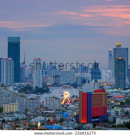 Landscape view of a residential and business district in Bangkok. Ferris is the focus in the evening.