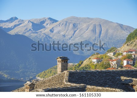 Landscape view of a village with houses  in the fall with all the colorful foliage in Grecee Metsovo - stock photo
