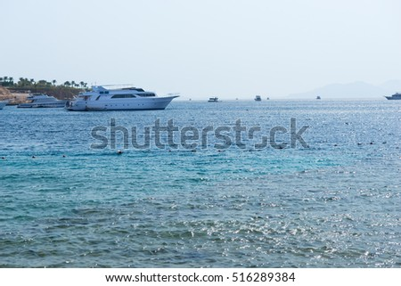 Landscape view of beautiful seaside with yacht
