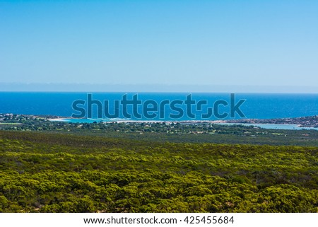Landscape View of grass sea and sky. Grass land with indian ocean sea with blue sky. beautiful view of landscape in western Australia.  - stock photo