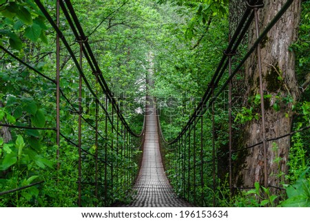 Landscape view of Long Steel Suspension bridge in Russian Mountains