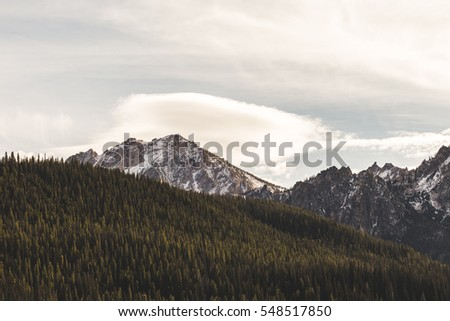 Landscape view of mountains, trees, and clouds near Stanley, Idaho, USA.