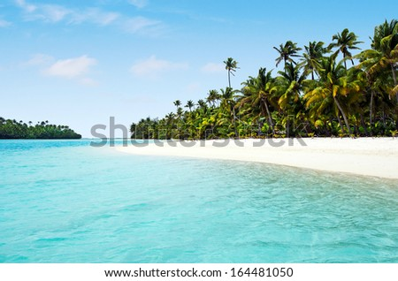 Landscape view of One foot Island in Aitutaki Lagoon Cook Islands. - stock photo