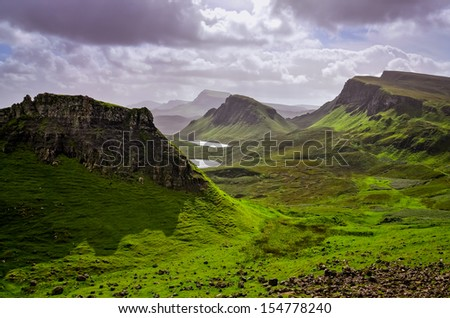 Landscape view of Quiraing mountains on Isle of Skye, Scottish highlands, United Kingdom - stock photo