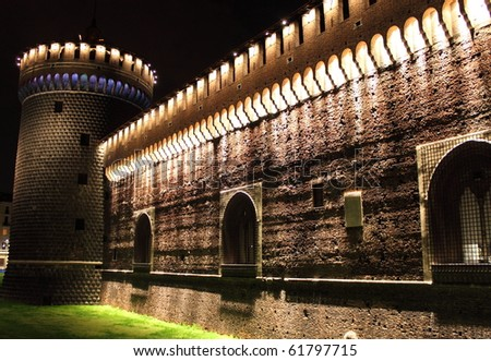 Landscape view of Sforzesco castle in Milan by night, Italy - stock photo