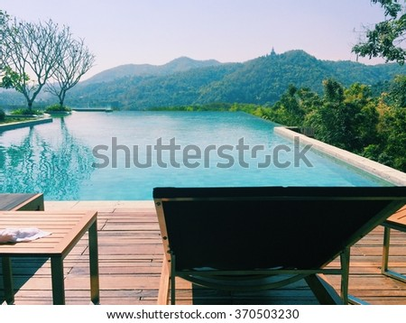 landscape view of swimming pool and top  of mountain view and nature - stock photo