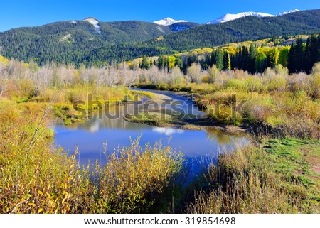 landscape view of the colorful alpine scenery with snow covered mountains during foliage season at Kebler and Ohio Passes - stock photo