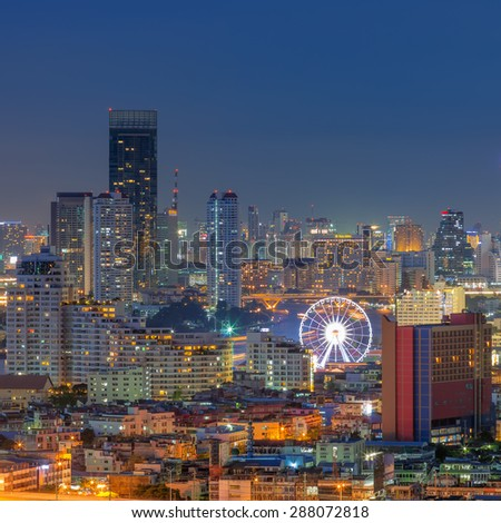 Landscape view of the residential and business district in Bangkok. Ferris wheel is an important point at twilight. - stock photo