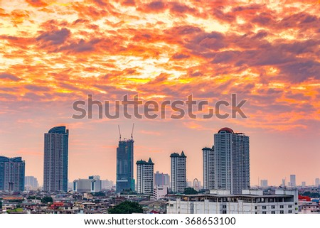 Landscape view of the residential and business district in Bangkok. Ferris wheel is an important point at twilight.