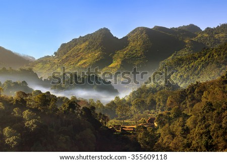 Landscape view the top of mountain on misty morning. This place is located in front of the Tea plantation 2000 's entrance at Doi Ang Khang in Chiang Mai, THAILAND. - stock photo