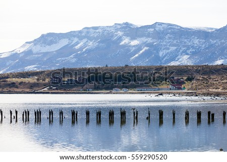 Landscape views of the mountains on the background and bay water from the Puerto Natales town in the south of Chilean Patagonia.
