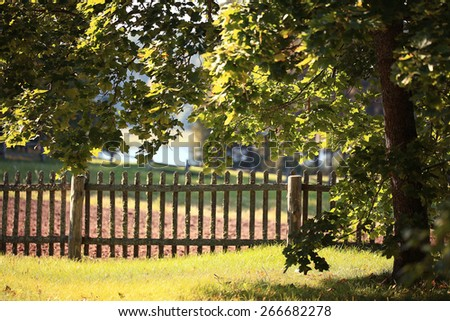 landscape village fence pumpkin house - stock photo