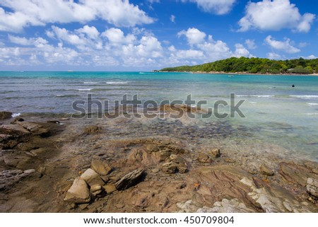 Landscape white beach and rock, the sea and the beautiful clouds in the blue sky - stock photo
