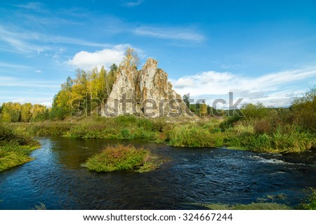 landscape with a rock near the river in autumn
