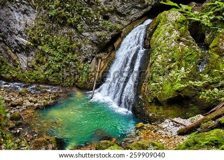 Landscape with a waterfall in the mountains and lush vegetation - stock photo