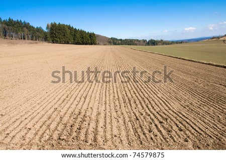 Landscape with arable land, forest and hill. - stock photo