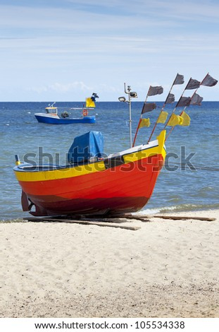 Landscape with Baltic Sea. Fishing boat on the beach. - stock photo