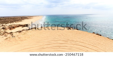 Landscape with beach, the sea and the clouds in the blue sky, Boavista - Cape Verde - stock photo
