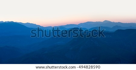 Landscape with blue mountains at sunset