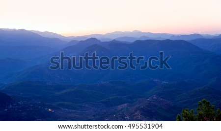 Landscape with blue mountains with sunset