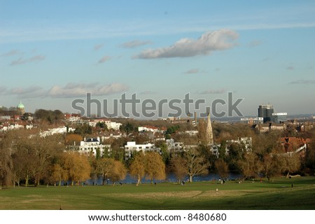 landscape with blue sky in a park in london on a cold winter day - stock photo