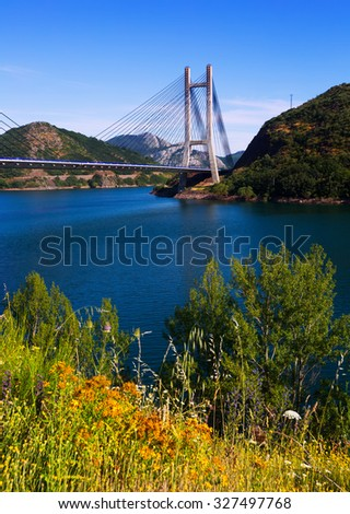 Landscape with cable-stayed bridge over lake in mountains of  Leon, Spain    - stock photo