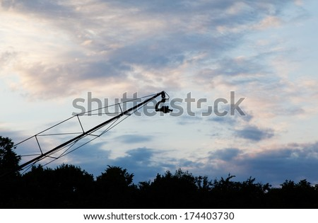 Landscape with camera on crane - stock photo