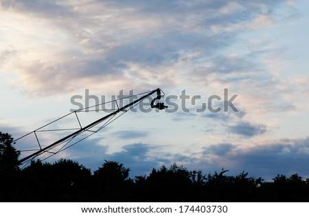 Landscape with camera on crane - stock photo