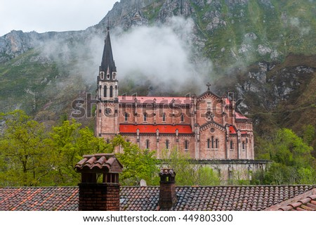 Landscape with castle in fog - stock photo
