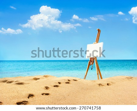 Landscape with easel on summer sunny day on the beach. Recreation concept - stock photo
